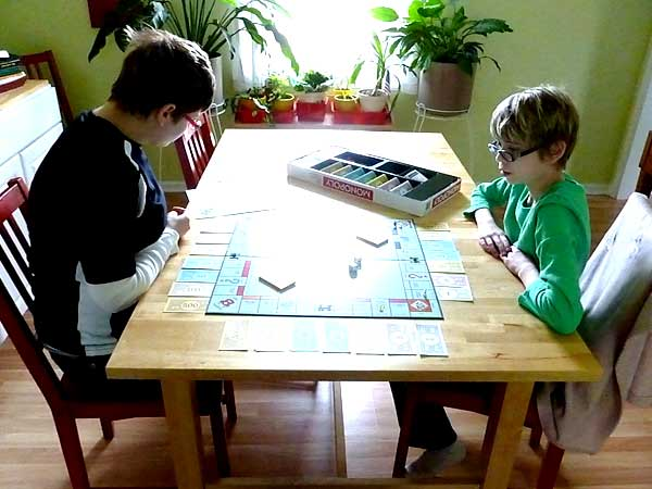 Homeschoolers playing Monopoly