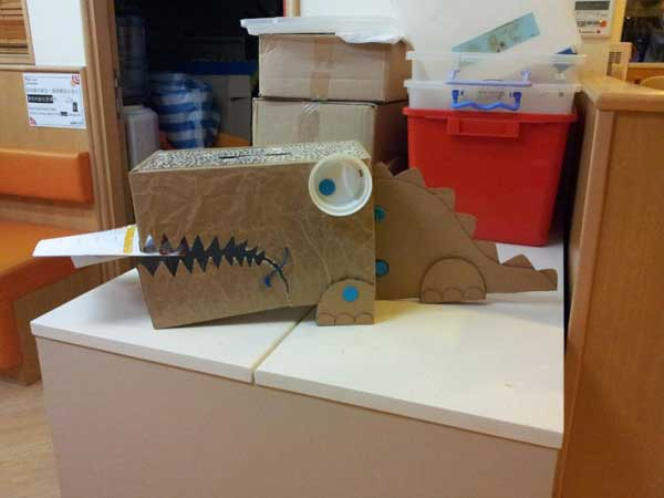 MAKEDO dinosaur out of recycled boxes
