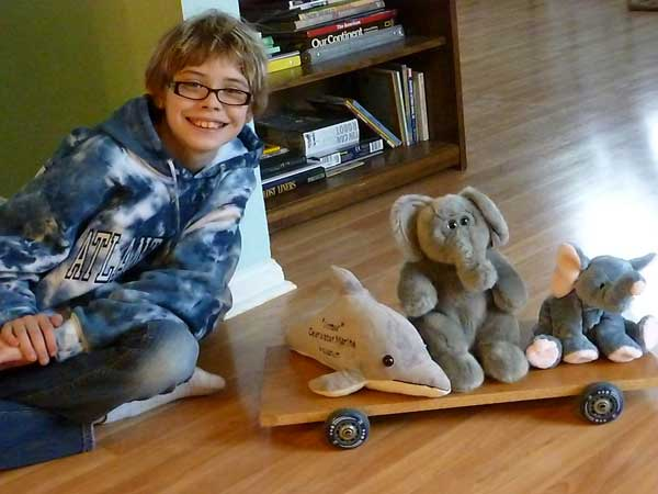 Stuffed animals get a ride on our homemade skateboard