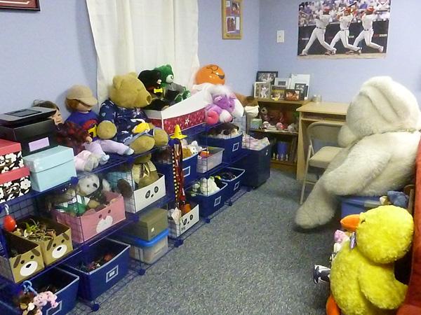 Homeschoolers' finished basement rec room with storage bins