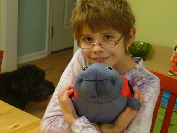 Sarah with a stuffed ladybug she received for her 11th birthday