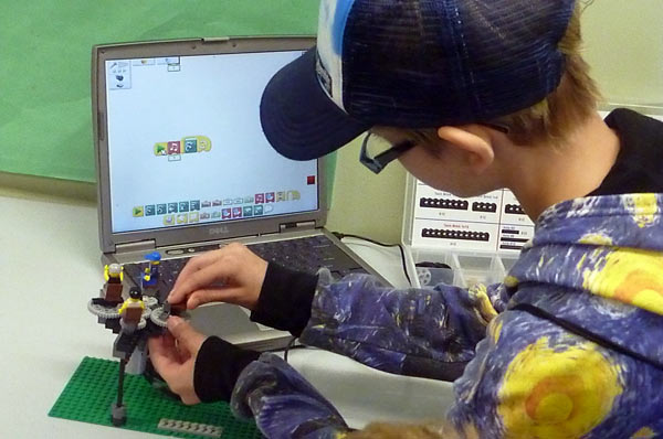 Working on a LEGO robotics project with WeDo software