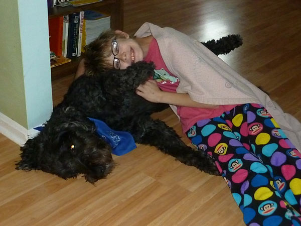 Cuddling the dog during a thunderstorm