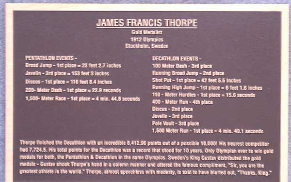 Plaque honoring Native American athlete Jim Thorpe on his tomb