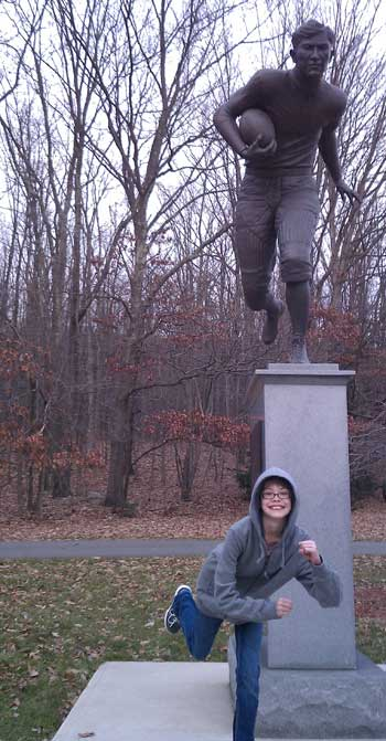 Posing with a statue of Jim Thorpe playing football