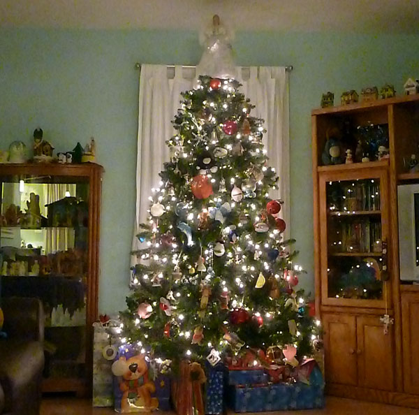 Family Christmas tree with gifts