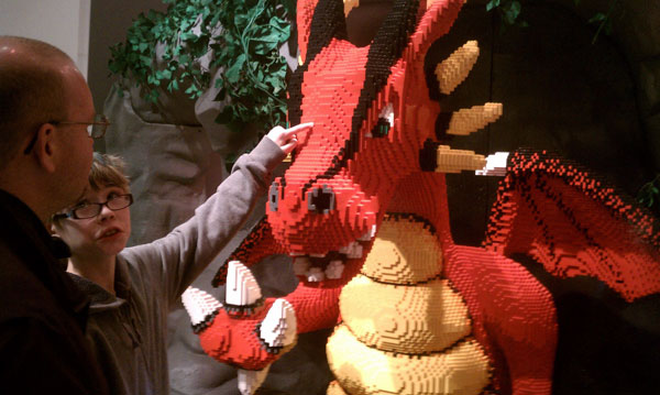 Pointing out the glue holding together a LEGO dragon at Reading Public Museum in Reading, Pennsylvania