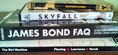 Collection of James Bond books and movies