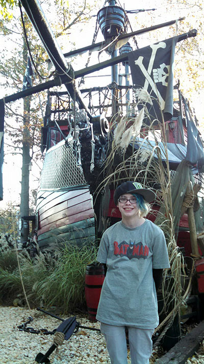 Ashar with a pirate ship at the Pennsylvania Renaissance Faire