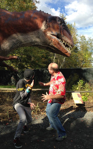 Unrelated to movies, Sarah and Chris being scared - uh, not really - by a Reptiland dino.