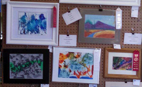 Sarah's paintings - Jazz Bluebird, top left, and Geordi's Visor, bottom center - won ribbons at the York Fair.