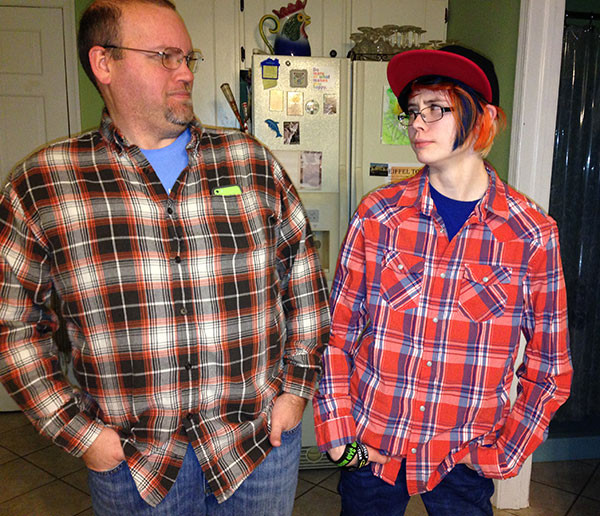"Sarah looked at Chris in mid-February and said, ""We're having a plaid day!"" She was making a face here because he didn't have his thumbs out of his pockets originally."