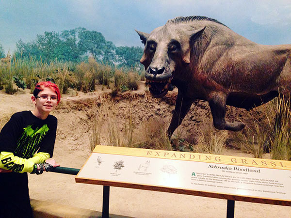 At the Museum of Nature and Science in Denver, Colorado, Ashar made a prehistoric pig friend.