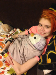 Unschooling in January 2016: This is my favorite stuffed penguin, Pink (or pengin, as well call them). Ashar got Pink her own blankie and wrapped her up tight. When Sarah's anxiety bothers her, hanging out with our stuffed friends is a huge help.