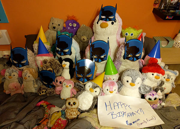 Also participating in the celebration of Sarah's birthday were Some Friends, Mostly Pengins. They had Batman masks and party hats in her honor. (This was all Dan's doing, and she LOVED it.)