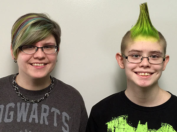 Of note in March: Sarah and I got our hair done. We do it about 4 times a year, always in some crazy color and/or style. Sarah has a black and green mohawk; I have green, teal and purple streaks and blonde highlights. We're kind of rockstars.