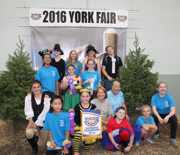 Unschooling in September 2016: Here's the York County 4-H Alpaca Club at their York Fair show, with their amazing leaders Beth and Sheri. Sarah is wearing her Alexander Hamilton costume from the costume contest.