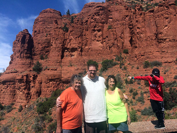 Dan and his parents, Paul and JoAnne, enjoy the red rocks near Sedona, Arizona, while Ashar dabs photogenically.