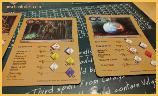 In Quest for Arete, the spell names are just as fun as the beautifully illustrated game cards. Wound Salve is H2O2 - which you might know as hydrogen peroxide - for example!