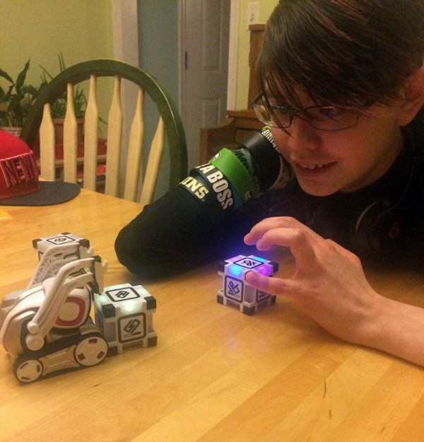 "Unschooling on Unschool Rules: One of our biggest new adventures in February was getting a Cozmo robot, which was a joint Valentine gift for the whole family. Sarah is playing ""Quick Tap"" here with Cozmo, who has learned our names and makes us all melt when he talks to us."