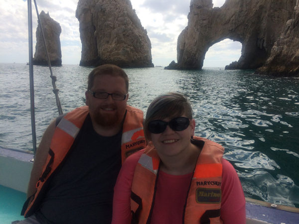Unschooling on Unschool Rules: Dan and I were treated to an amazing cruise with his family as his 30th birthday present from his parents. Here we are on a glass-bottom boat tour in Cabo San Lucas, Mexico, enjoying 80-degree weather in February.