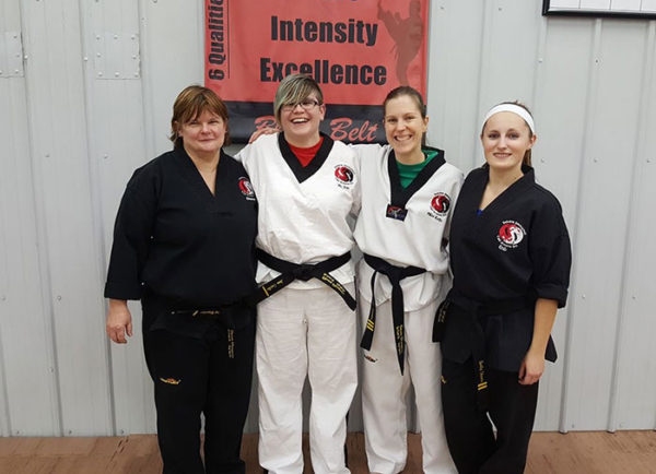 "Unschooling on Unschool Rules: February's highlight for me (besides safely arriving home from our big trip) was getting back into regular tae kwon do practice. Here I am (second from left) with some of my fellow ""dragon ladies."""