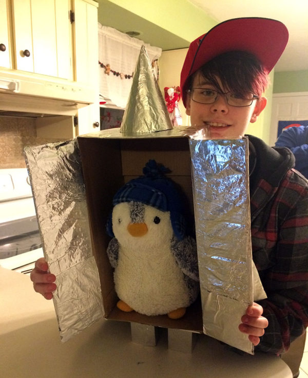 Unschooling on Unschool Rules: After a trip to the local science center and its planetarium in January, Sarah thought Plaid Pengin would like to have his own rocketship. One roll of tinfoil later...