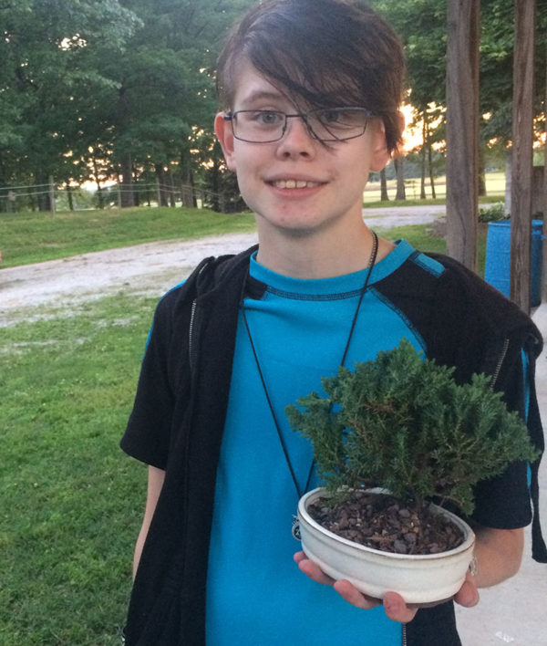 "Unschool Rules - June 2017 - One of Sarah's 4-H clubs made bonsai juniper trees as a project - here she is with ""Pricky,"" as she aptly named him."
