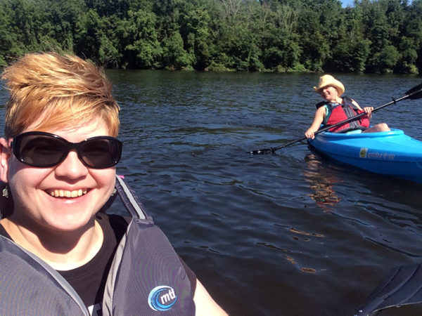 Unschooling in July 2017 on Unschool Rules: Thanks to my friend Kara (right), who kindly let me try her kayak, I ALSO have become a kayaker. Here we are on the first voyage of my kayak, Orange Crush, which looks exactly like Kara's blue kayak, except... it's orange.