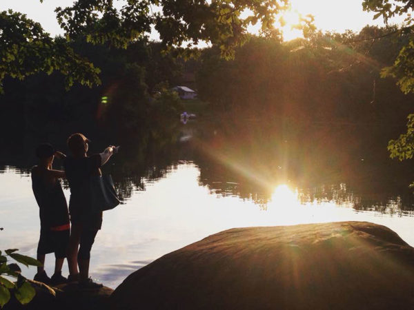 Unschooling in July 2017 on Unschool Rules: Chris, Sarah and I took a sunset hike at Pinchot Park in early July. (Awesome silhouette photo by Chris)