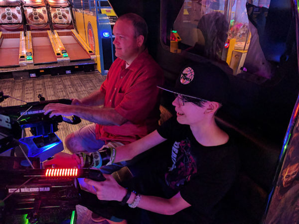 Unschooling in July 2017 on Unschool Rules: Chris and Sarah had a thrilling time killing zombies in the Walking Dead game at Dave and Buster's.