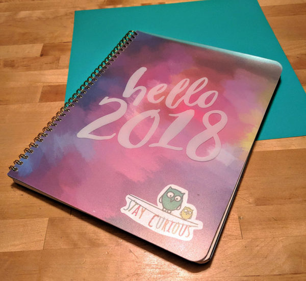 "Unschool Rules guide to an unschooling planner system: My base planner is the 2018 ""Hello, Aquarelle"" from Orange Circle Studio."