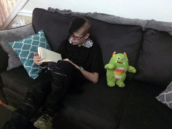 Unschooling in August 2017 on Unschool Rules: Ashar REALLY loved reading James Patterson's Humans, Bow Down, ably assisted by stuffed monsteroo Whip.