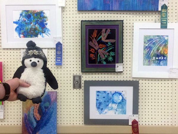 Unschooling in September 2017 on Unschool Rules: Apollo Pengin was proud to see some of my art win at the York Fair. Owlish, at the top left, placed first; Wormhole Continuum, at the bottom, placed second. The one at right, Awake, is by me too, but didn't win. (We think that art with words on it isn't popular with judges.)