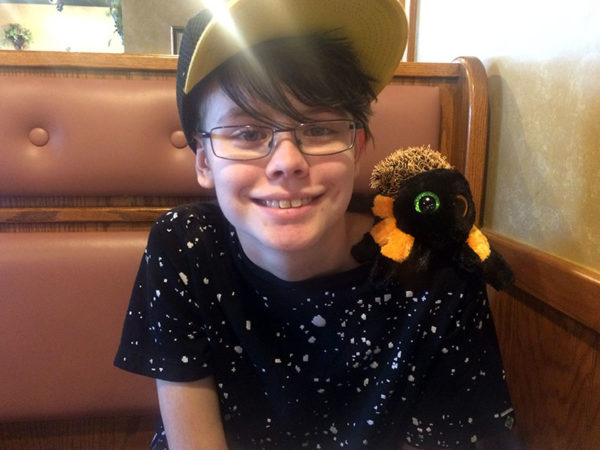 Unschooling in September 2017 on Unschool Rules: Sarah and her new pet tarantula, Horus, made a great team at an Italian restaurant in the Selinsgrove area on our September road trip.